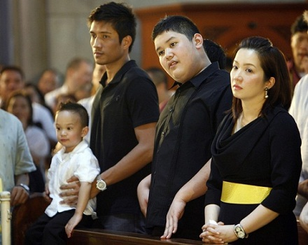 Aquino, her husband Yap holding Baby James and her eldest son Joshua