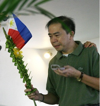 Jun Lozada attending a Palm Sunday mass while under the protection of