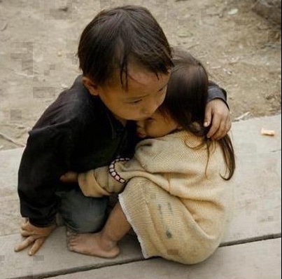 I'm not sure of teh nationalities of these children. But their caring fro each other is heart-rending.