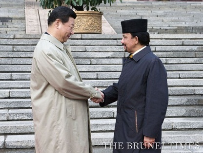 Sultan of Brunei Bolkiah is welcomed by Chinese President Xi Jinping in Beijing. Photo from Brunei Times.