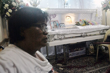 Jennifer Laude's mother at her wake. From Bulatlat.