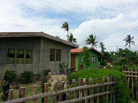 Manicani today. Two of the  more than 400 houses built by Nickel Asia Corporation for victims of Yolanda.