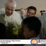 Pope Francis greets and hugs two kids who gave him flowers