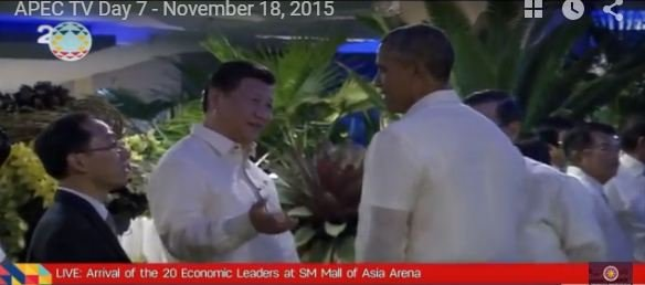 Chinese Presifent  Xi Jinping and U.S. President Obama talk about jet lag at pre-dinner conversation Mall of Asia arena. Beside Obama, hidden from the camera, is Taiwan's Vincent Siew.