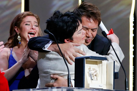 2016 Cannes Film Festival Best Actress  Jaclyn Jose hugs Director Brillante Mendoza upon receiving award. Daughte Andi Eigenmann looks on