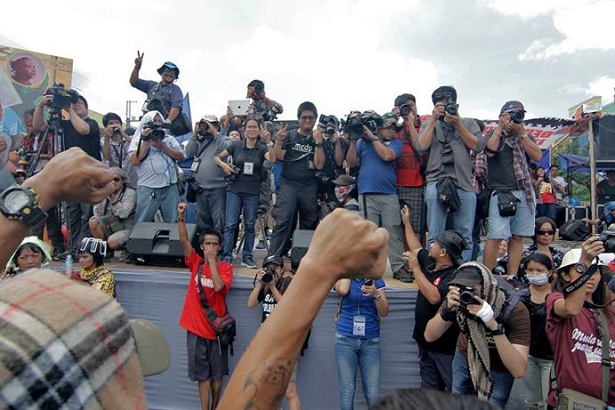 Photo-journalists capture the moment.Photo by Vincent Go
