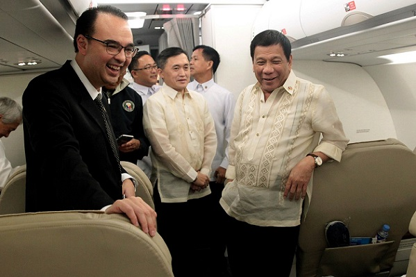 Incoming foreign secretary Alan Peter Cayetano has been a regular part of Pres. Duterte's delegation in all the latter's foreign trips. This Malacañang photo was taken  on board the presidential plane to Malaysia.